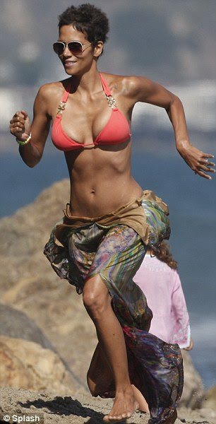 Perfect Baywatch audition: Halle showed wonderful form as she ran along the beach in the style of David Hasselhoff