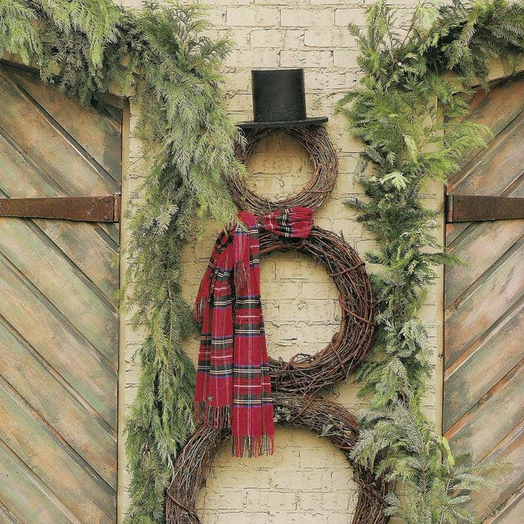 Snowman out of wreaths...so cute. #pinspiration
