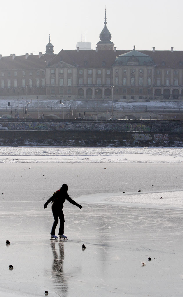 A Warsaw resident skates on the frozen River Vistula in Warsaw, Poland, Sunday, Feb. 5, 2012. Across Eastern Europe, thousands of people continued to dig out from heavy snow that has fallen during a c