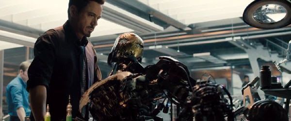 Tony Stark stares at one of his robotic creations in 2015's AVENGERS: AGE OF ULTRON.