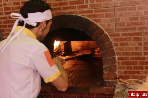 779e8901d14ee بالصور لاجئون سوريون يفتتحون مطعما للمأكولات الشامية في غزة - Lookstylish