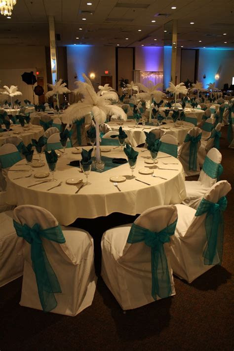 Elegant purple and blue with feather centerpieces.   Sweet