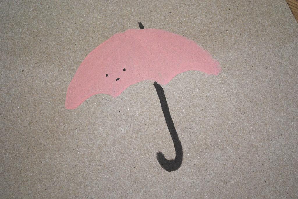 painted umbrella on kraft paper