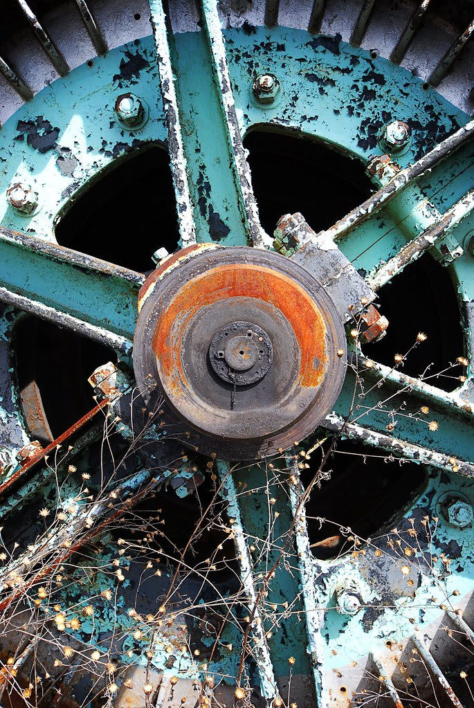 Close-up of the axle of a large wheel.