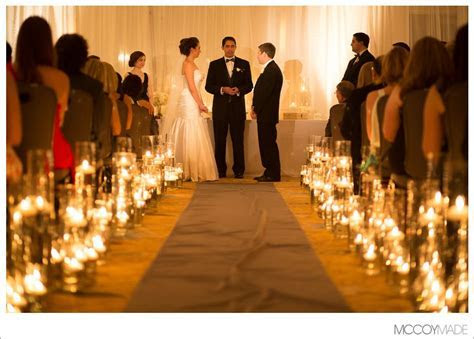 candle lit cylinder vase wedding aisle   knox college