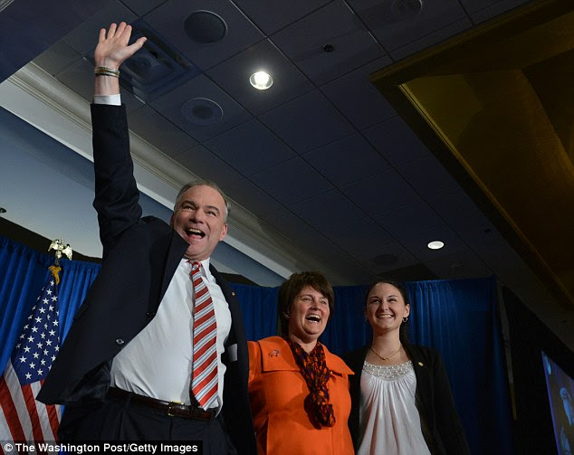Tim Kaine's wife Anne (center) is Virginia's education secretary and daughter Annella is an NYU student. Above, the trio celebrate Kaine winning a seat on the Senate in 2012