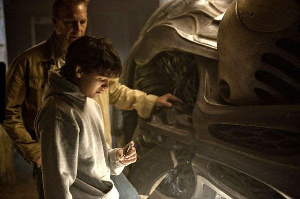Jonathan Kent (Kevin Costner) tells a young Clark (Dylan Sprayberry) about his true identity in MAN OF STEEL.