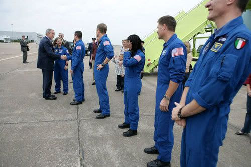 President Bush greets the STS-120 crew outside Air Force One, on the tarmac at Ellington Field in Houston, Texas.