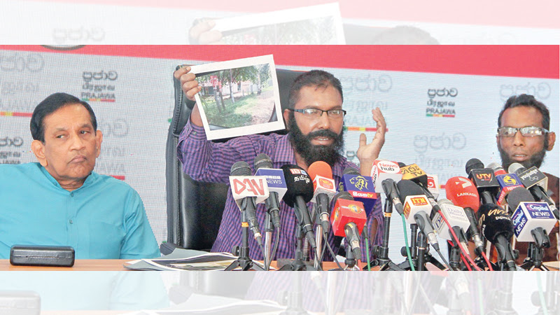 Minister Rajitha Senaratne with the 'White Van' drivers at the press conference yesterday.Picture by Kelum Liyanage.