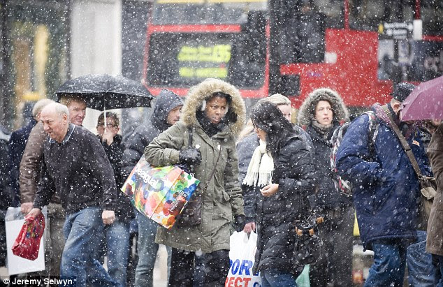Chilly: Christmas shoppers in central London were  caught in snow flurries today