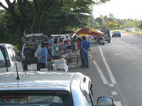 Roadside stall selling selling seafood and vegetable near Bako Causeway.