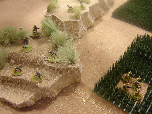 Dismounted soldiers descend into fields