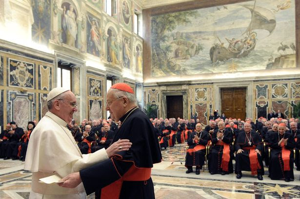 Newly elected Pope Francis I, Cardinal Jorge Mario Bergoglio of Argentina, meets cardinals in the Clementine Hall at the Vatican