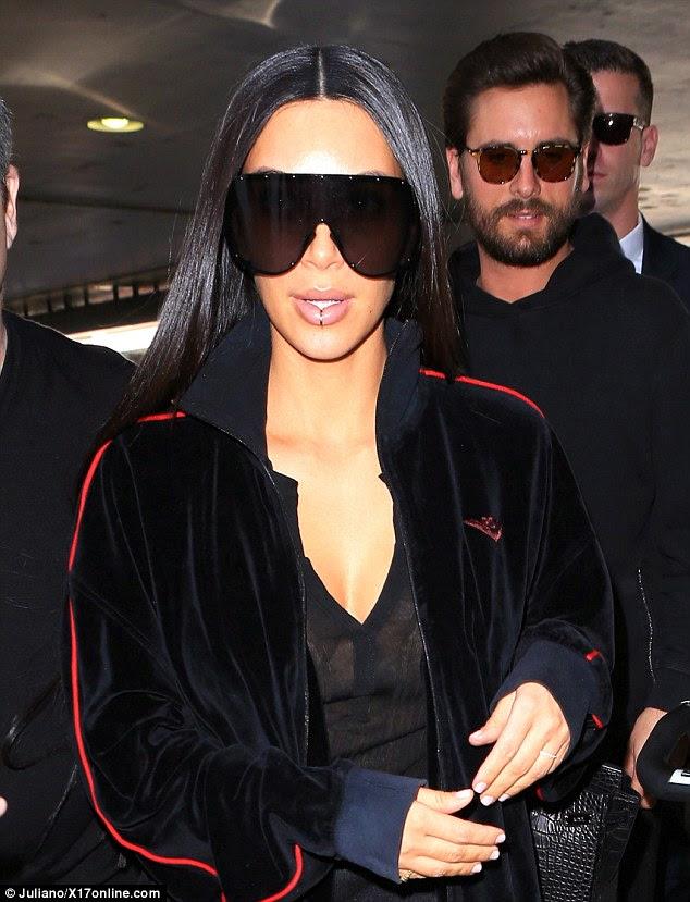 Voltar ao trabalho: Kim Kardashian foi retratado na LAX na quarta-feira junto com Scott Disick como ela se preparou para ir para Dubai para um tutorial de maquiagem
