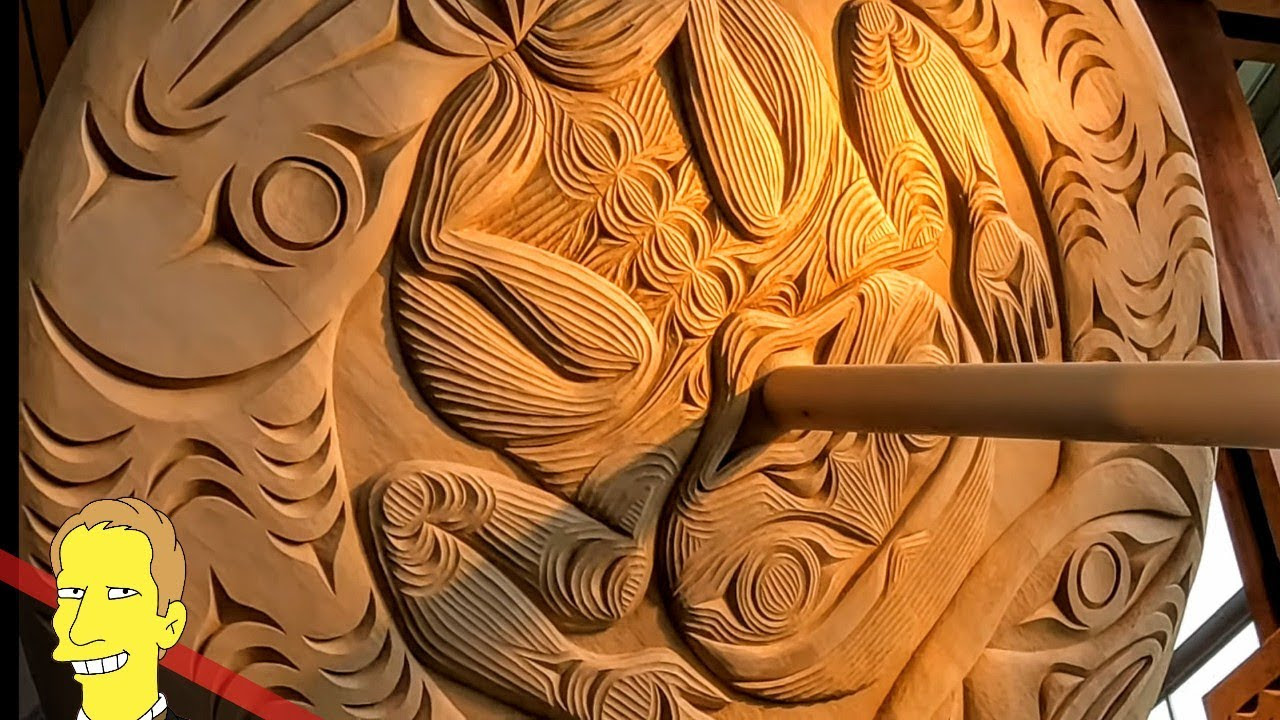 Closeup of detailed first nations carving of wooden spindle at Squamish Lil'wat Cultural Centre