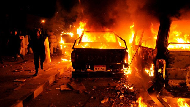 PHOTO:A riot policeman passes burning vehicles during clashes outside the U.S. embassy in Cairo, Egypt, early Thursday, Sept. 13, 2012, as part of widespread anger across the Muslim world about a film ridiculing Islam's Prophet Muhammad.