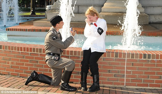 Bended knee: Dressed in full Nazi regalia with the Swastika tattoo on his neck visible, Campbell got down on bended knee to pop the question to Bethanie White