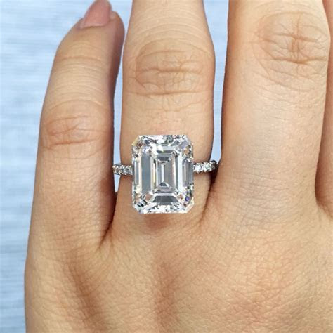 5ct emerald cut solitaire in platinum with diamond band