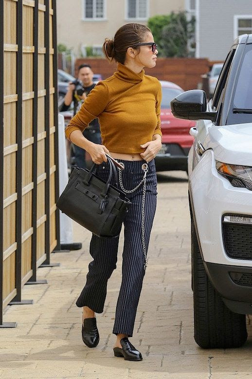 Le Fashion Blog Selena Gomez Mustard Turtleneck Pinstripe Cropped Trousers Black Slide On Mules Via Vogue