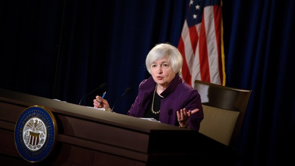 """Federal Reserve Chair Janet L. Yellen speaks during a press briefing at the Federal Reserve June 17, 2015 in Washington, DC. The Federal Reserve left its benchmark interest rate unchanged at near zero Wednesday, while describing US economic growth as """"moderate"""" after the winter slowdown. But predictions made by the individual participants in the Fed's monetary policy meeting indicated most expect the federal funds rate to rise above 0.5 percent by year-end. The Federal Open Market Committee trimmed its economic growth forecast for 2015 to just 1.8-2.0 percent, down from March's 2.3-2.7 percent outlook, to account for the unexpected contraction in the first quarter of the year. AFP PHOTO/BRENDAN SMIALOWSKI (Photo credit should read BRENDAN SMIALOWSKI/AFP/Getty Images)"""