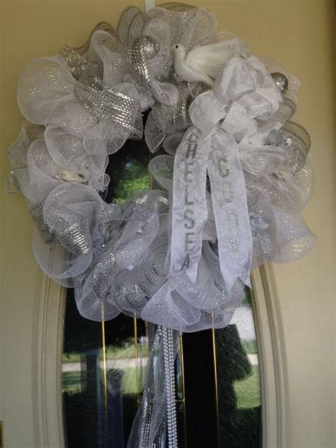 Wedding wreath made from deco mesh and ribbon. Includes