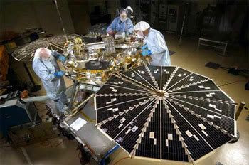 Technicians work on the Phoenix lander at the Lockheed Martin facility in Colorado.