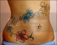 Sexy rose tattoo on hot girl's belly.