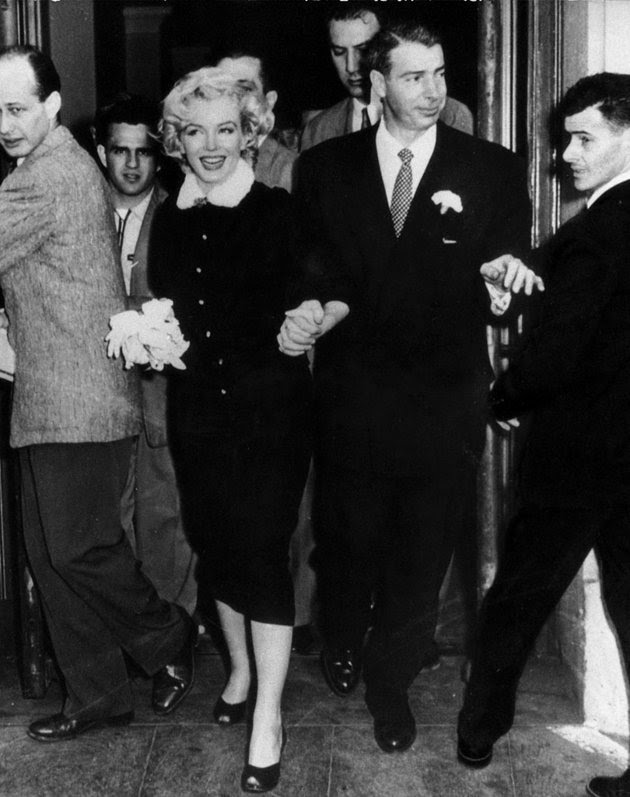 Marilyn Monroe was unique and so was her bridal look. When the world-famous actress married baseball legend Joe DiMaggio at San Francisco City Hall in 1954 she wore a dark suit with mink-fur trim. The