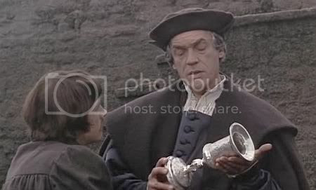 Paul Scofield handing a chalice to John Hurt in A Man For All Seasons