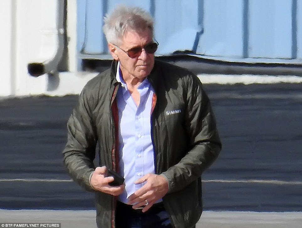 Ford (pictured at Santa Monica airport Sunday) just missed the passenger jet after he accidentally landed on the taxiway