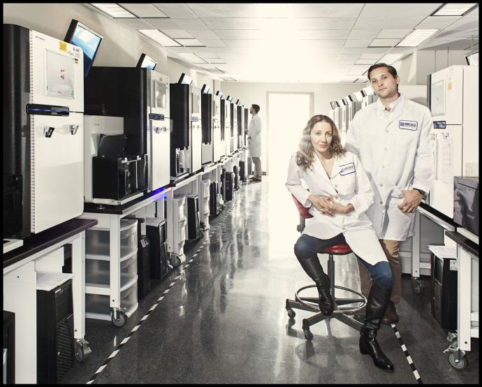 Pardis Sabeti and Stephen Gire in the Genomics Platform of the Broad Institute of M.I.T. and Harvard, in Cambridge, Massachusetts. They have been working to sequence Ebola's genome and track its mutations.
