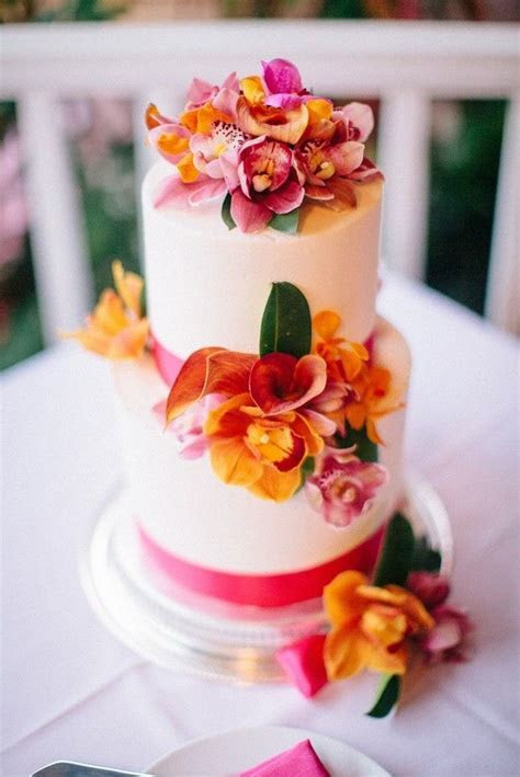 Deck out your tropical wedding cake with orchids for a fab