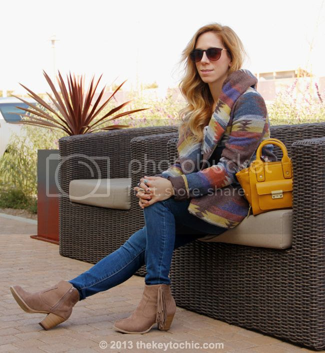 L.A. fashion blogger The Key To Chic wears Old Navy Rockstar jeans,a Phillip Lim for Target mini satchel, a Mossimo blanket print wrap coat, and Wet Seal fringe boots.