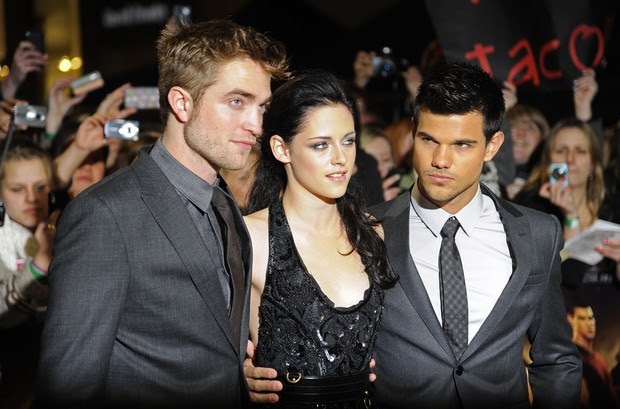 Robert Pattinson, Kristen Stewart e Taylor Lautner em Londres  (Foto: Agência/Reuters)