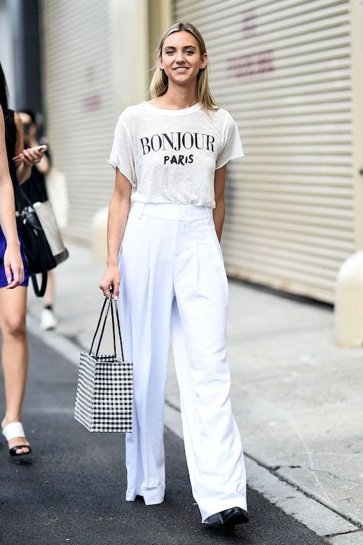 Le Fashion Blog Street Style All White Look Graphic Tee Bag High Waisted Trousers Leather Ankle Boots Via Style Caster