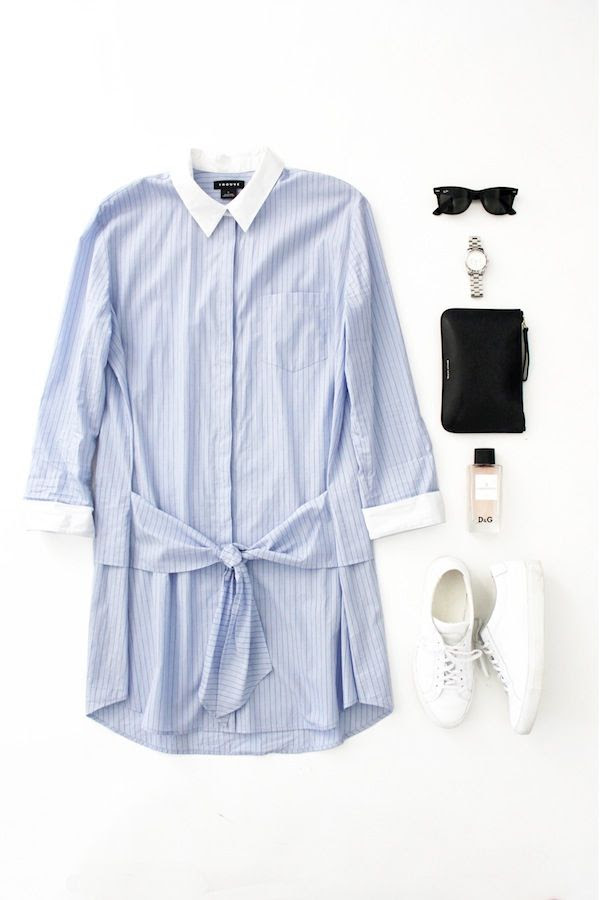 Le Fashion Blog Spring Outfit Flat Lay Blue Tie Front Shirt Dress Wayfarer Sunglasses Silver Watch DG Perfume Mansur Gavriel Pouch Common Projects Sneakers