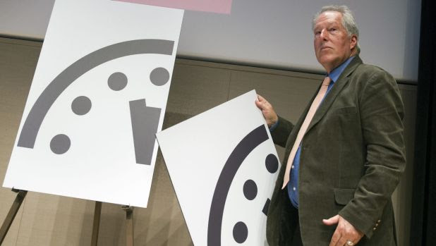 Climate scientist Richard Somerville, a member, Science and Security Board, Bulletin of the Atomic Scientists, unveils the new Doomsday Clock in Washington.