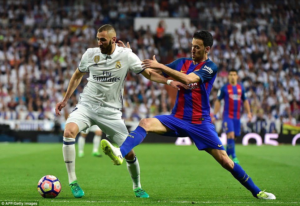 Karim Benzema looks to hold off Sergio Busquets but the Frenchman was once again a peripheral figure in a central role