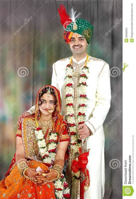 Indian Couple In Their Wedding Dress Stock Photo   Image