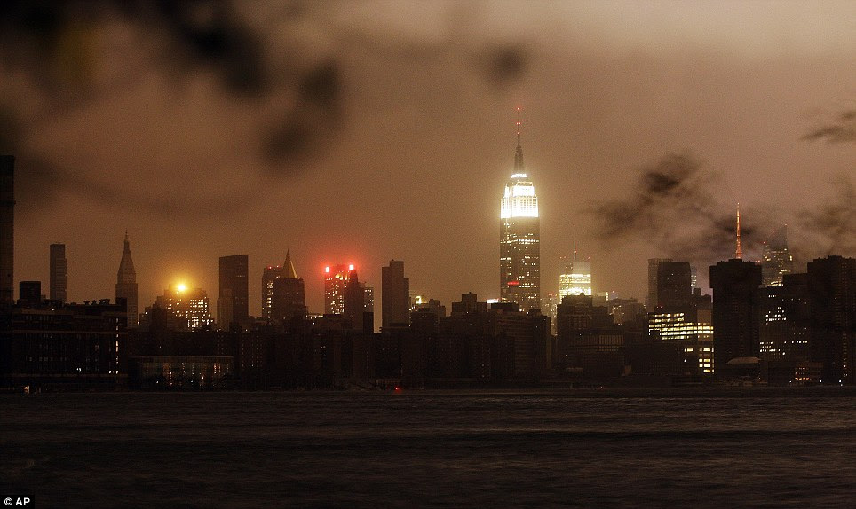 Empire State: The New York skyline remains dark on Monday as seen from the Williamsburg neighbourhood in the Brooklyn borough of New York