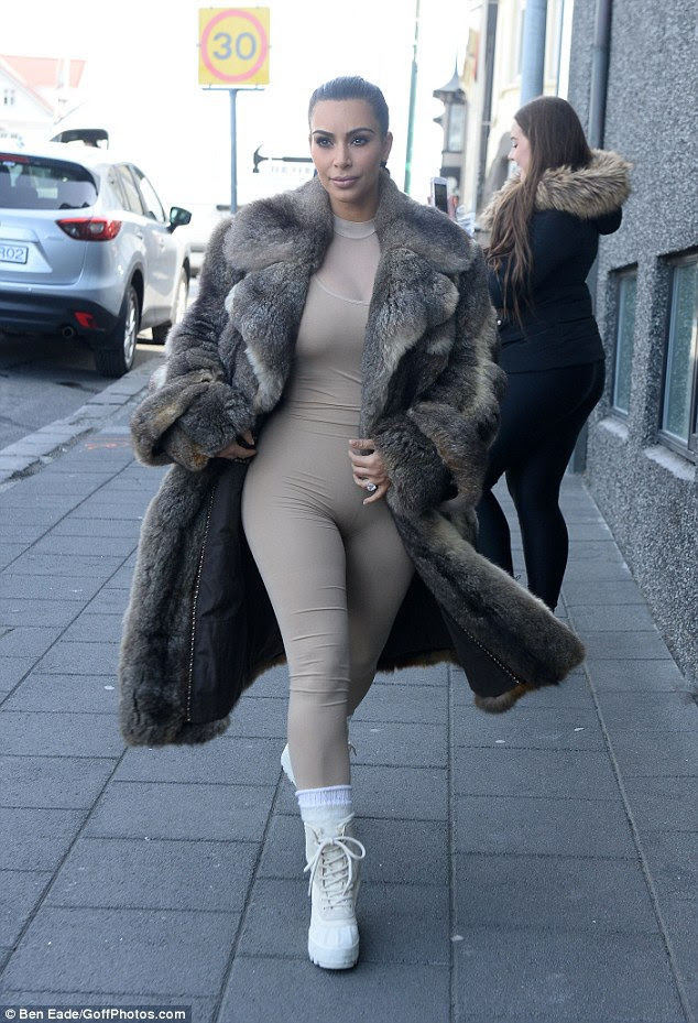 How nude! Kim Kardashian rocks her favourite underwear as outerwear look with full body Spandex layered under a fur coat as she goes sight seeing in Iceland on Monday