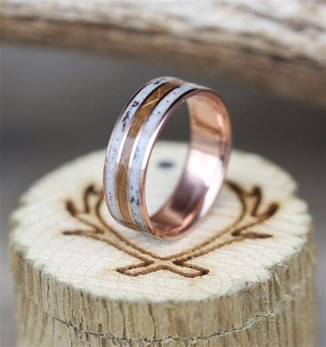 rose gold mens wedding ring featuring whiskey barrel