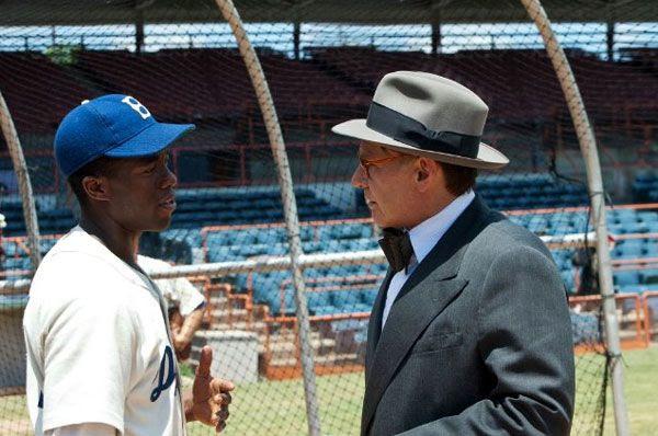 Jackie Robinson (Chadwick Boseman) and Branch Rickey (Harrison Ford) talk baseball in 42.