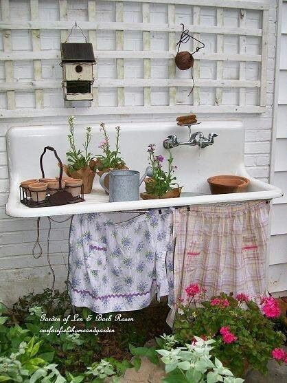 Shabby garden deko! Use old sink, trellis, aprons, etc. I love this idea - now to find a sink!!