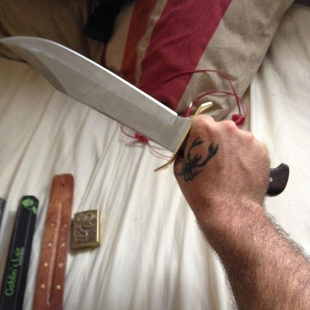 Detectives are looking for 6ft-tall Allen following the deaths of a man, 44, a woman, 48, and a six-year-old girl in the quiet town of Didcot. Pictured: A photo of a knife in what appears to be Jed Allen's hand on his Instagram