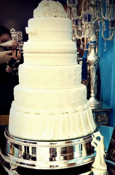 5 tier ivory round wedding cake with white flowers on top