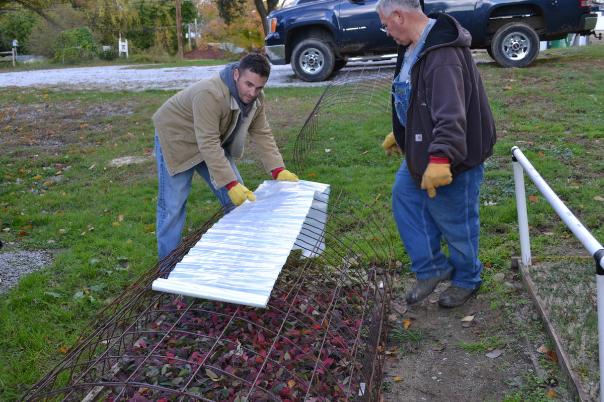 Mike & Duston McGroarty building a mini hoop house.