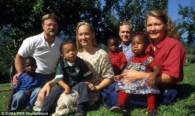 Dolezal rarely discusses her childhood, but it has been reported that she was born into a family rooted in extreme Christianity. Above, she is pictured center with her parents, her biological brother Joshua and her adopted siblings