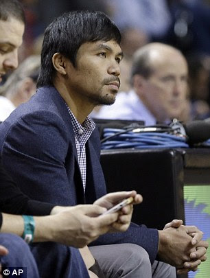 Manny Pacquiao watches the game between the Miami Heat and the Milwaukee Bucks