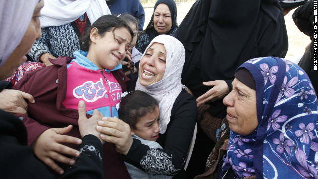 Palestinian women and children cry during the funeral of Audi Naser on Friday.